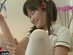 Japanese slutty teen chick strokes cunt with dildo