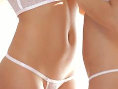 Delightful blonde and brunette in hot underwear are enjoying lesbian sex