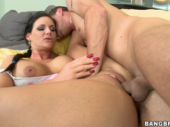 Buxom hot brunette chick Phoenix Marie is pleasantly riding big dick in reverse cowgirl pose